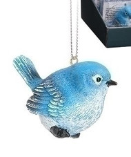 """2.5"""" Bluebird of Happiness Ornament. The Blue Bird of Happiness is made of resin.  The blue jay resonates truth, faithfulness, and solidarity because they are vigilant in their tasks. They also keep the same mate for life, which is symbolic of endurance, patience and loyalty.  Card on back of the box reads:  """"Let this little Bluebird hang on your tree, to remind you of the nest that shaped you into who you cwould be. Adventrues and glights might keep you at a distanc, but true happiness is found in a trip home for Christmas"""""""