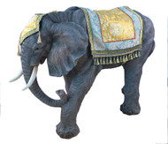 Nativity elephant with intricately detailed headpiece and rug on its back.