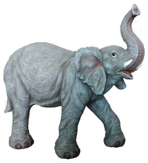 Large fiberglass and resin elephant with its trunk raise and one foot in the air.