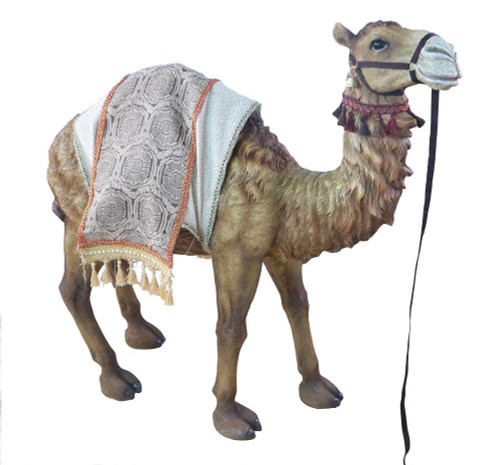 Intricately detailed Nativity camel with a rug on its back.