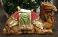 Camel with intricately detailed blanket and saddle stool.