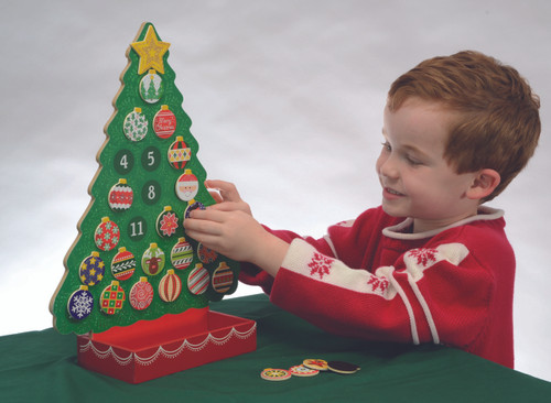 "Fun for all ages, this magnetic Countdown to Christmas Advent Calendar is the perfect way to prepare and get ready for Christmas day! The set includes 24 unique magnetic ornaments plus a shining star for Christmas day--all of which fit neatly in the attached box at the base of the tree.  Kids can hang tree ornaments every day as they count down for the days leading up to Christmas. They'll also love to switch, move, and rearrange the pieces to customize their very own tree countless times! Dimensions are 12"" X 16.5"".  New This Year... the Baby Jesus and Merry Christmas pieces are include!"