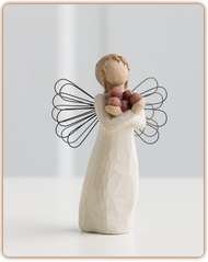 Bring an abundance of health and happiness into your home with this 5 inch tall angel of good health angel figurine holding apples