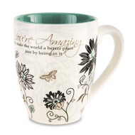 "From the Mark My Words Collection comes this 4.75"" ~ 17 ounce ceramic mug.  ""You're Amazing! You make the world a better place just by being in it."" written on front of mug."