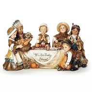 """10"""" Tabletop Scene of Pilgrim children and Native American children at Thanksgiving table. """"We are Truly Blessed"""" is written on tablecloth. Dimensions: 5.5""""H 10.5""""W 5""""D"""