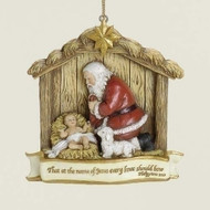 "Kneeling Santa Nativity Ornament. 3.5""H x 1""W x 3.75""D. Resin/Stone Mix"