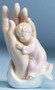 """Porcelain Statue of a Girl in the """"Palm of a Hand"""". Perfect Gift for a Baptism! 4.38""""H 3""""W 2.25""""D"""