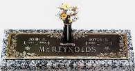 "C-GB135 V1 ""Dynasty Dogwood"" Companion Bronze over Granite with a vase"
