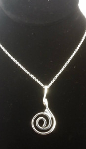 """A Sterling Silver"" Celtic Spiral Pendant & Chain close up view."