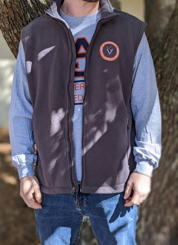 Port Authority fleece vest in iron grey with the orange vet school seal