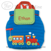This backpack is shown with a name monogrammed on the flap using the Comic sans font. The thread used for the name matches the bag straps.