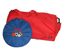 Royal Blue Roll Bag with Cooper Letter Style Monogram and Sports Ball Design. (Shown collapsed for easy storage.)  Red Roll Bag (Shown expanded with shoulder strap.)