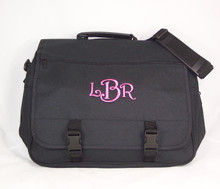 This monogrammed expandable briefcase was stitched with hot pink thread using the Harrington Letter Style.