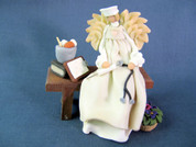 Nurse Angel on Bench Polymer Clay Figurine
