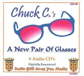 A NEW PAIR OF GLASSES WITH CHUCK C. AUDIO CD'S