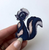 Hungry Designs Bambi Flower The Skunk Brooch - In Hand - Cobalt Heights