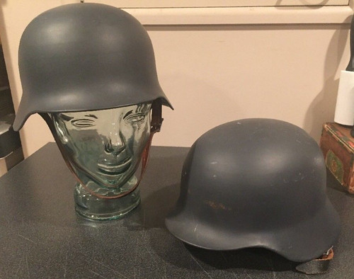 Pair of metal reproduction German military helmets with liners