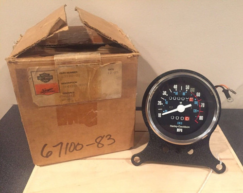 NOS HARLEY-DAVIDSON SPEEDOMETER WITH 3 HOLE BRACKET   #67100-83 ZERO MILES , SHOPTHEGARAGE
