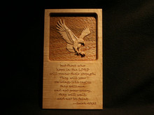 "Maple plaque containing a 3 Dimensional Carving of an Eagle, viewed straight on, Carved from Maple and set in a bed of Textured Red Oak, Plaque is engraved with Isaiah 40:31 ..  ""but those who hope in the LORD will renew their strength.  They will soar on wings like eagles;  they will run and not grow weary,  they will walk and not be faint.""     12""w x 7.5""h..  Keyholes routed into back for easy wall mounting.."