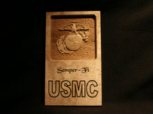 "Maple plaque containing a 3 Dimensional Carving of the USMC Eagle, Globe, and Anchor, viewed straight on, Carved from Maple and set in a bed of Textured Red Oak, Plaque is engraved with USMC, Semper Fi ..    12""h x 7.5""w..   No keyholes on back"