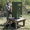 Texas Hunter 300 lb. Stand and Fill Directional Wildlife Feeder on wooden platform.