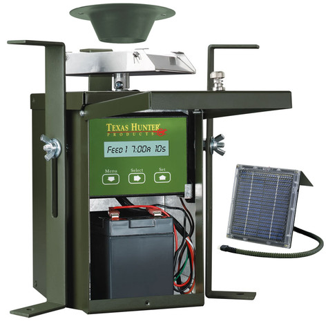 Texas Hunter 12 Volt Wildlife Feeder Kit Inside View with 12 Volt Rechargeable Battery and 12 Volt Solar Charger