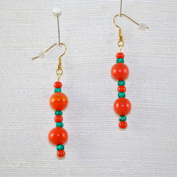Close up of fish hook style drop earrings