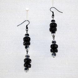 Detailed view of drop earrings