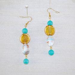 Close up of drop earrings.