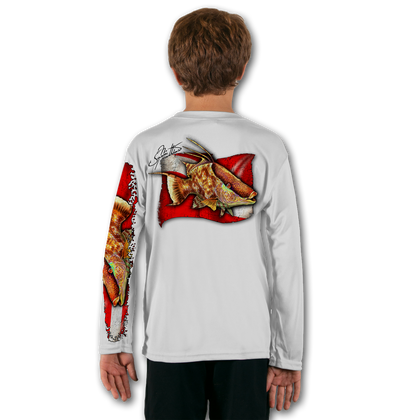 White  Stay cool with Jason Mathias's popular line of T-shirts for boys and girls! Catch your kids a Jason Mathias youth tee to match the one that you have, or help inspire their love for their favorite fish species like this awesome scene featuring a Big male Hogfish framed infront of a rugged dive flag. This fine art design is sublimated using superior technology that definitely makes for a top favorite among all young anglers and outdoor enthusiasts worldwide!  Say goodbye to sunburns and hello to the supreme comfort of the Jason Mathias youth Solar Performance Long Sleeve shirt! This awesome shirt offers superior sun protection and performance qualities. It is so comfortable that you will feel like you're not even wearing a shirt! Our shirts don't snag or catch, which makes it a must when doing what you do best! Featuring up to UPF +50 solar protection, the Solar Performance Long Sleeve is lightweight, comfortable, and sure to keep the sun's rays from penetrating through to your skin. This fabric is powered by PURE-tech™ moisture wicking technology which will keep you cooler in the summer and warmer in the winter.  Fabric: 4.1oz. / 100% Performance w/ UPF Protection  Made in USA