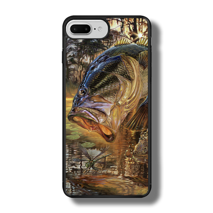"""iPhone 7 Plus fine art phone case"""" by artist Jason Mathias: Carry around this unique piece of personalized art of a trophy size Largemouth Bass jumping out of the sun set swamps after a dragonfly while protecting your phone all at the same time!  Our phone cases provide superior quality when compared with other slim silicone rubber cases. Our case provides a layer of silicone protection- and an extended lip to protect your phone screen from touching or rubbing on surfaces. Our cases also have a comfortable textured grip and easy access to all buttons and plugins. The art plate is extremely tough, a well shielded sublimated aluminum fine art plate that wont fade or scratch.  Case provides effective protection from dust, damage or any other unexpected situations.  (Made in the USA)"""