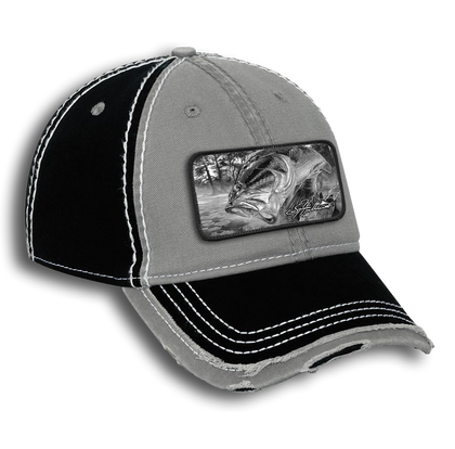 """The Jason Mathias garment washed cotton twill w/ heavy stitching distressed trim edge visor six panel low profile dad hat with a sewn on art patch is one heck of a hat. The patch features Jason Mathias's """"Dragon Slayer"""" a massive Largemouth Bass jumping out of the water for a dragonfly."""