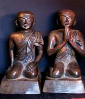 Front view of two bronze monks Burma.