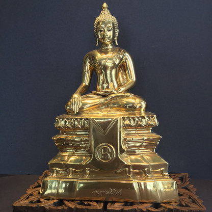 SONTORN BRASS THAI BUDDHA $2,400.00  PRODUCT DESCRIPTION  The Buddha is sitting in the Earth Touching, Calling the Earth to Witness, or The victory over (Subduing) Mara position.  He sits with folded legs (right on top of the left).  The left hand is held in his lap with the palm facing upward.  The right hand extends over the right thigh, near the knee, with the fingers pointing towards the ground, palm inward.  PRODUCT REVIEWS  QUANTITY: 1  WEIGHT: 6.50 LBS SHIPPING: Free Shipping Add to shopping bag