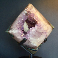 Polished Amethyst Geode with Calcite inclusion on spinning stand.  4.6 kilos.