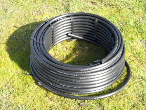 a-roll-of-black-polyethylene-pipe-for-the-high-lifter-water-pump.jpg