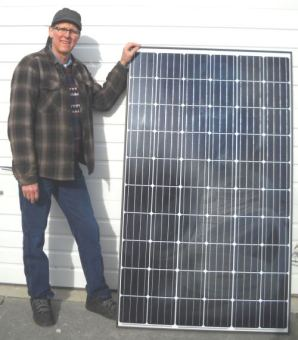 thad-and-solar-panel-cropped-and-lowres-298x340.jpg