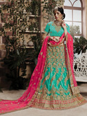 Incredibly Graceful Dark Aqua Blue Colored Net Lehenga