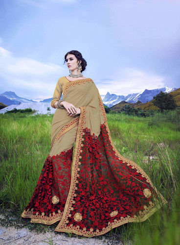 Delightfully Alluring Beige & Maroon Colored Dotted Georgette Saree