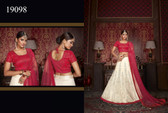 Exquisitely Crafted & Enthralling Off White Colored Silk Lehenga
