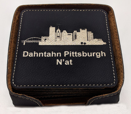 The coasters come in a black leatherette holder