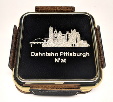 4 piece set of Pittsburgh themed brass framed coasters.   Laserable Leatherette offers the look and feel of genuine leather and allows colored engraving without use of paints or dyes.  This richly textured, synthetic material is water resistant, easy to clean and durable enough for the rigors of daily use. The color theme is black with a metallic look gold finish.  Our Pittsburgh sketches are unique to Signature Art Ware and are copyright of Karen Groll of McMurray PA.