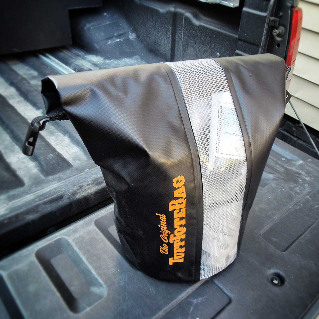 The unclipped handle that shows how the black class three waterproof Tuff Tote bag rolls open.