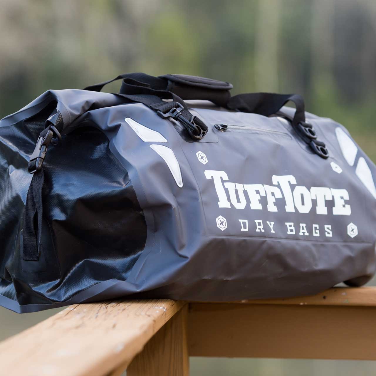 Side view of the gray class three waterproof duffle bag clip shut and secure.