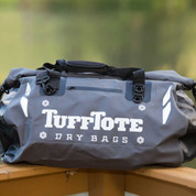 Class 3 waterproof gray duffle bag with clipped roll down top opening.