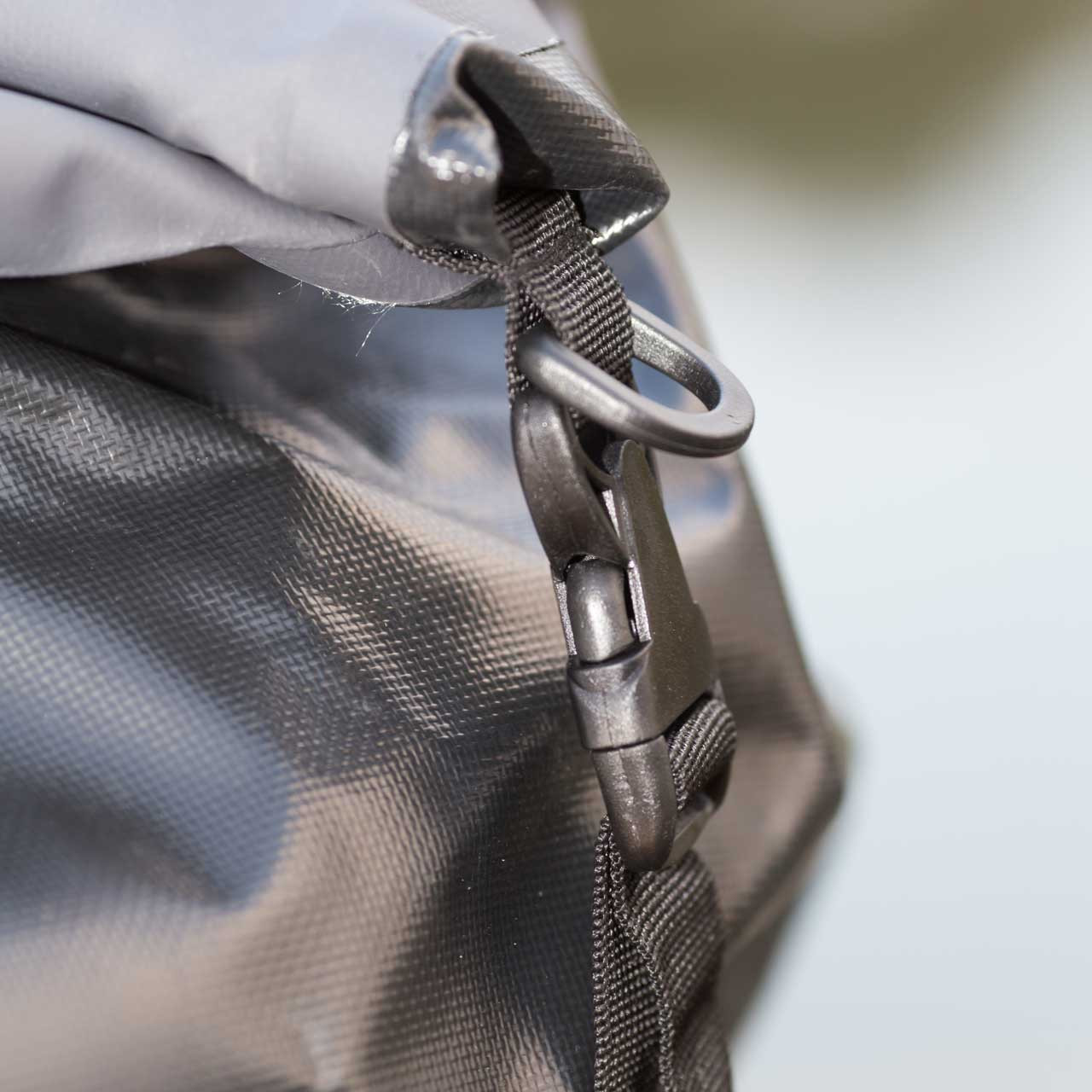 Close up of the side clip down that secures  the bag