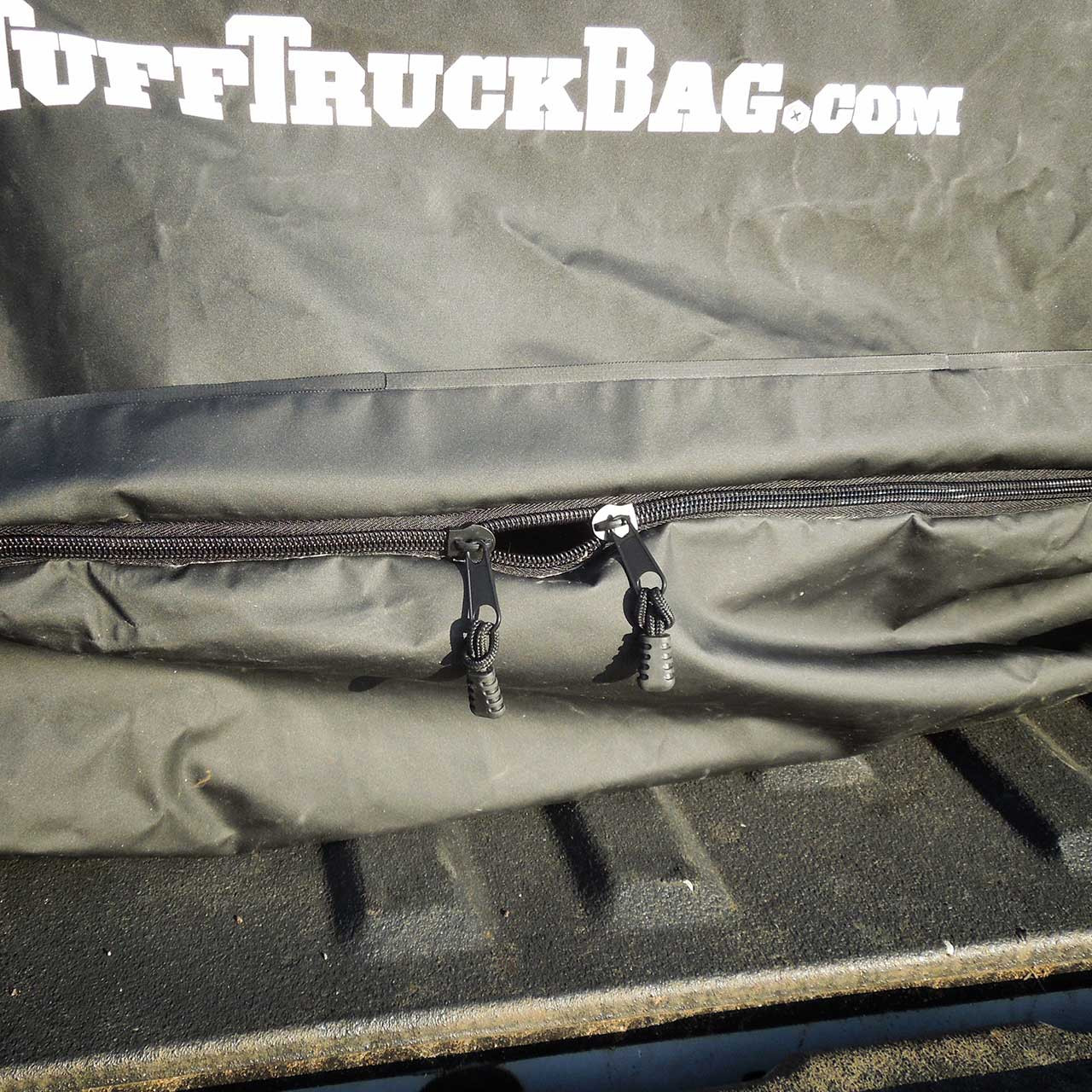 Heavy gauge zipper on the end of the black waterproof Tuff Truck Bag. Zipper on end closes to secure luggage and cargo