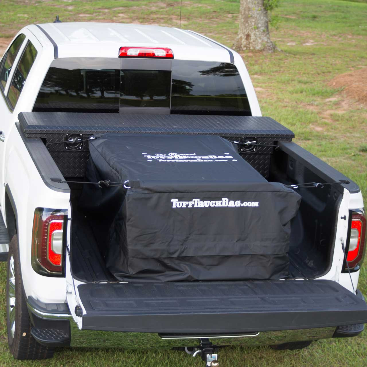 Back view of a black waterproof Tuff Truck Bag with the pickup truck tailgate down for full viewing