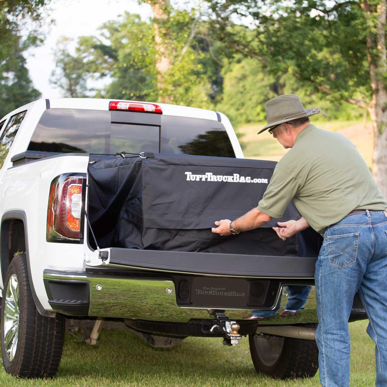 Black waterproof Tuff Truck Bag full of cargo in the back of a pickup truck bed
