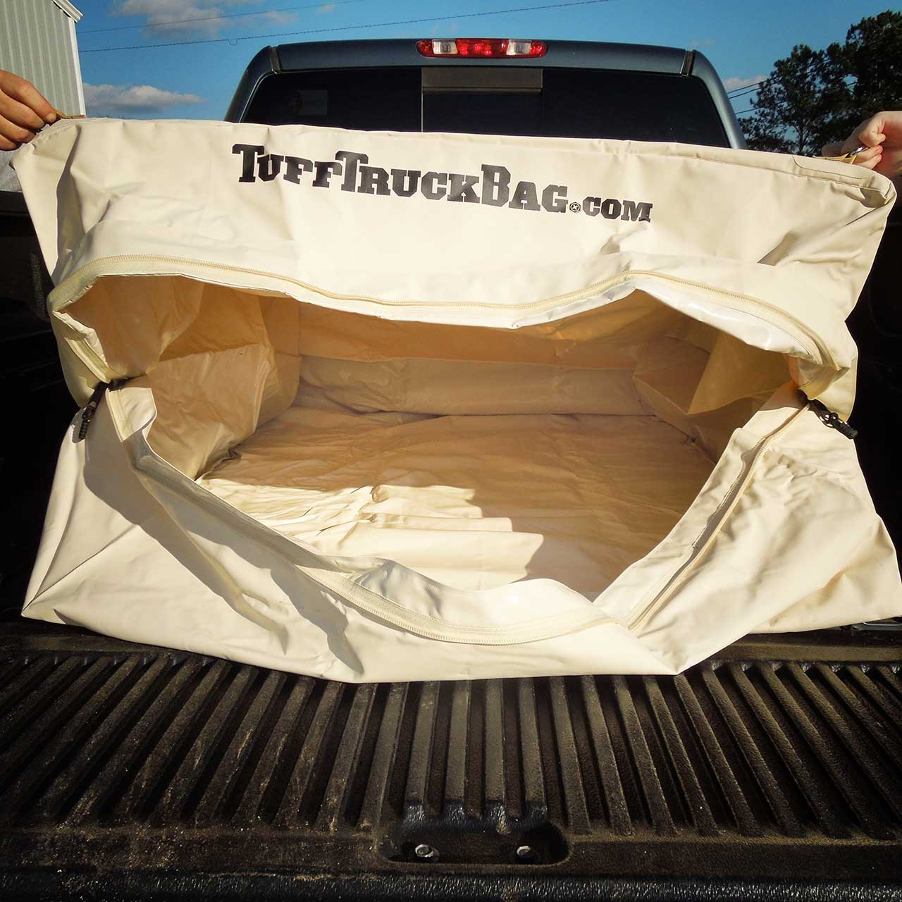 Back view of a waterproof Tuff Truck Bag with no cargo or luggage inside to see how much space is available to load into the bag.